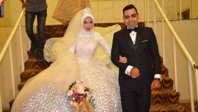 صورة تهنئة زفاف من الصحفي محمود العميد والإعلامية هبة حمزة